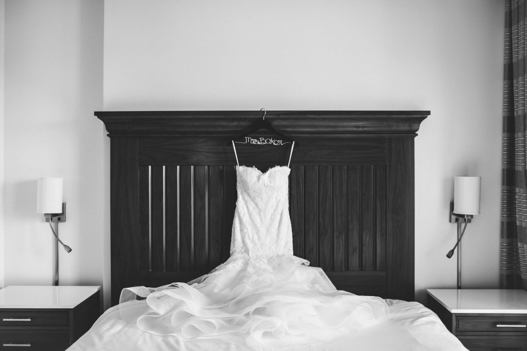 Budget Brides - Just Marry Weddings - Jessie Caparella -Wedding Dress placed on a bed's headboard