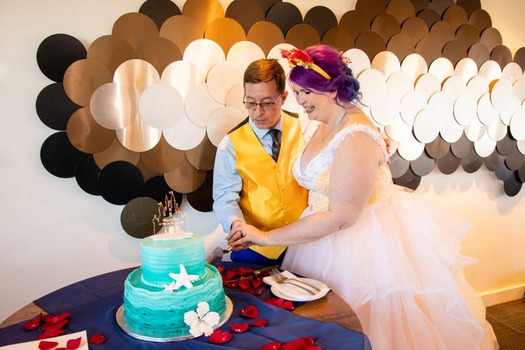 Disney Vow Renewal - Just Marry Weddings - David and Vicki Arndt Photography - Paddlefish - Cake Cutting