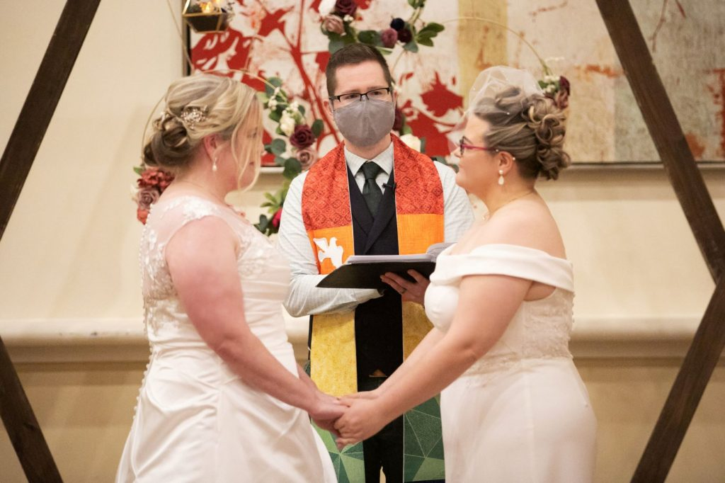 Rainy Day Wedding - Just Marry Weddings - Roots Photography - Brides Exchanging Vows