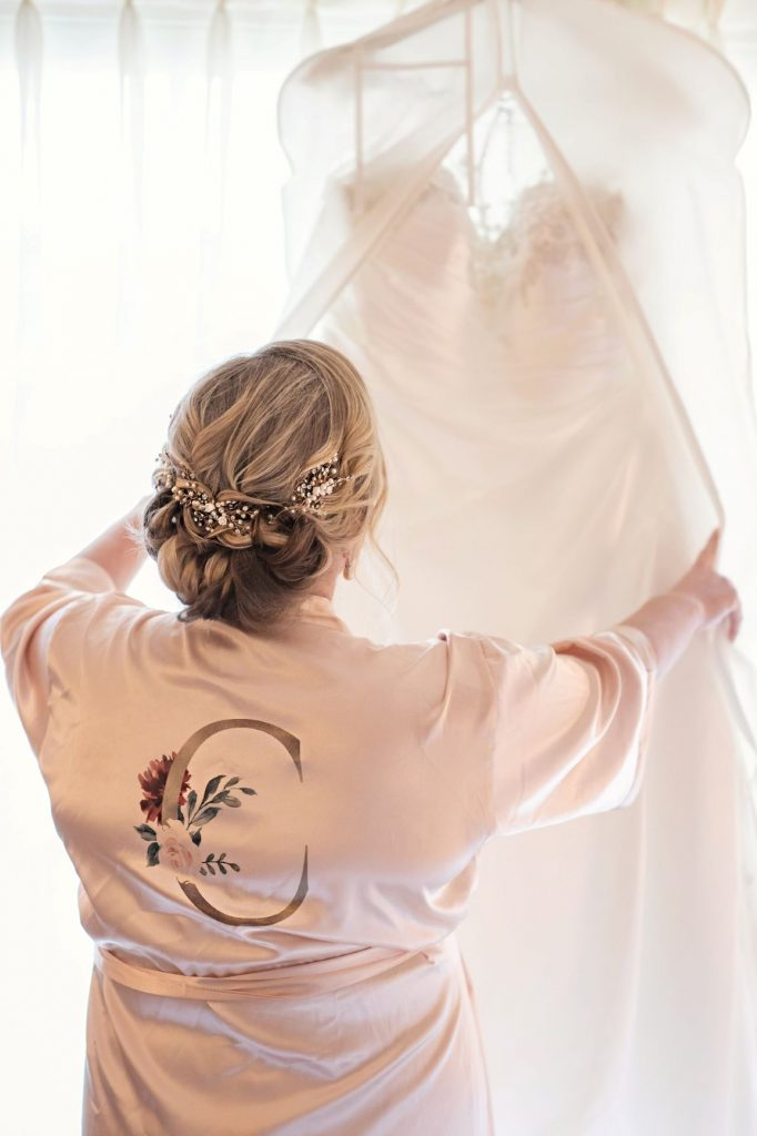 Rainy Day Wedding - Just Marry Weddings - Roots Photography - Bride Viewing Her Dress